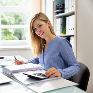 Female chartered accountant sitting at desk smiling
